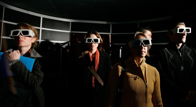 Image: Journalists wear 3D glasses during the presentation of a virtual tour of the villa of Livia,
