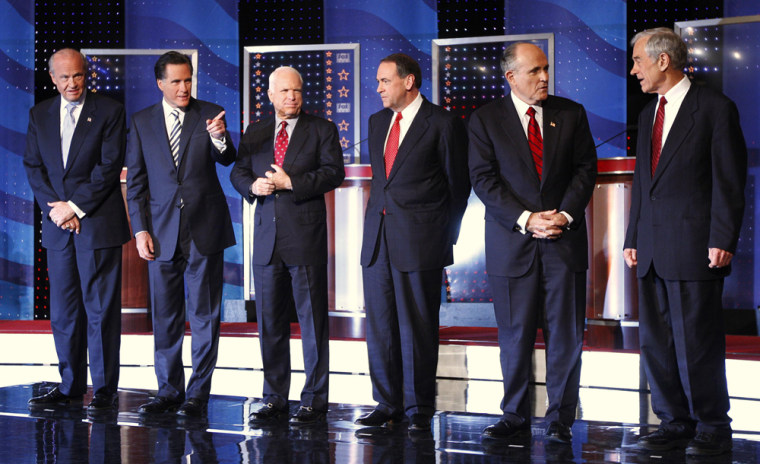 Image: Republican presidential candidates, Thompson, Romney, McCain, Huckabee, Giuliani and Paul, stand onstage together before the start of the Republican Party presidential debate in Myrtle Beach, South Carolina