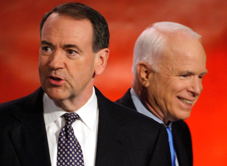 Republican Presidential candidates Huckabee and McCain meet onstage between back to back Republican and Democratic debates in Manchester