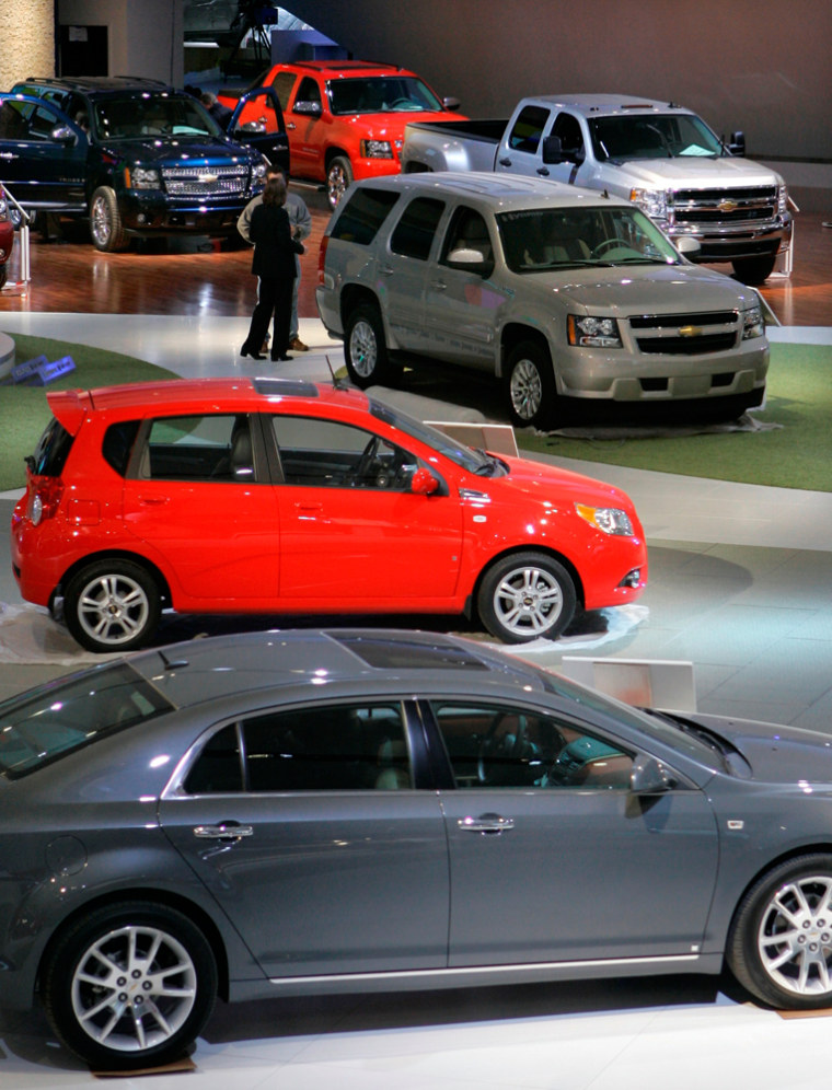 Image: General Motors vehicles are displayed at the North American International Auto Show