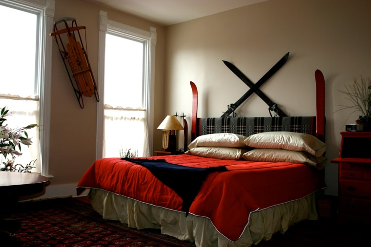 Image: A room at the Broadway Hotel in Philipsburg, Mont. with an old-fashioned sled and skis on the walls