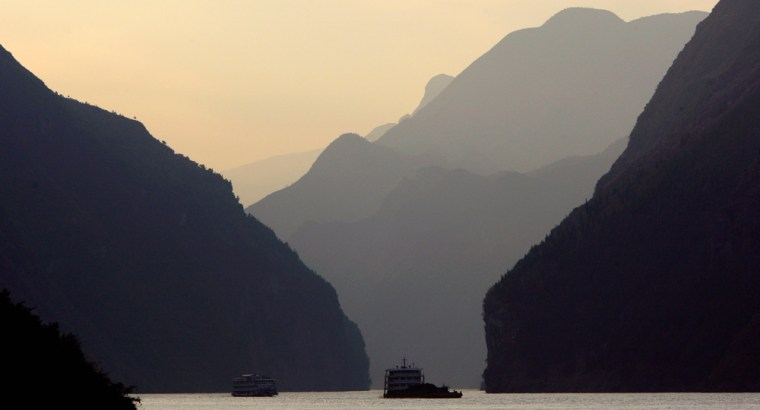 Image: A boat sails at sunset through an area on the Yangtze River known as the Three Gorges in Heibei Province near the town of Badong in the south-west part of China