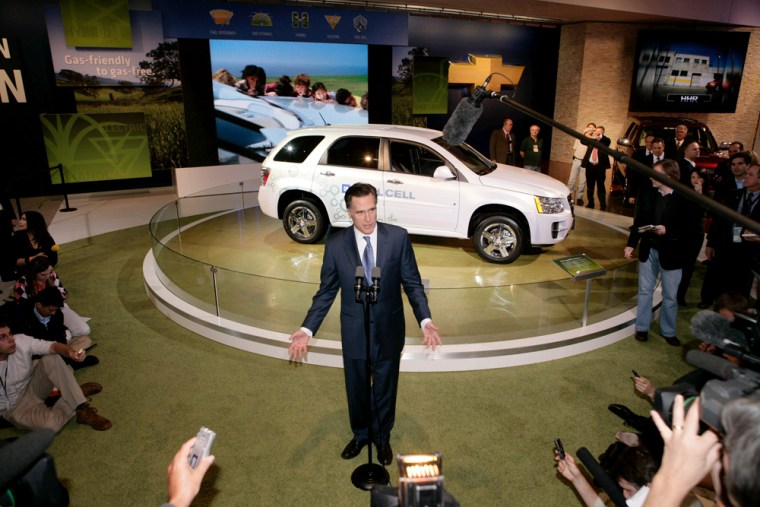 Image: Republican presidential hopeful Mitt Romney talks to the media in front of the Chevrolet Equinox Fuel Cell vehicle