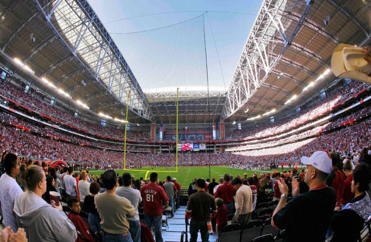 Image: Fans watch the Arizona Cardinals and Cleveland Browns from the south end zone at University of Phoenix Stadium