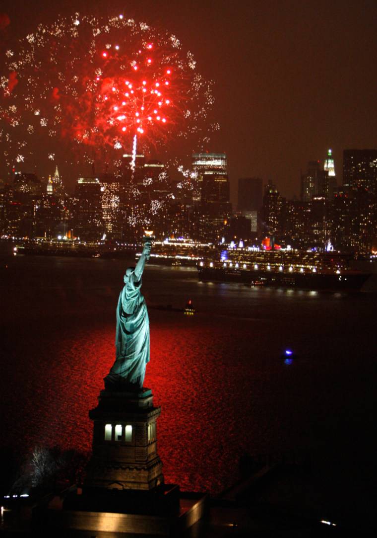 Image: Fireworks light up the sky over New York harbor as the Queen Mary 2, right, Queen Victoria, center, and Queen Elizabeth 2 rendezvous near the Statue of Liberty Sunday, Jan. 13, 2008 in New York