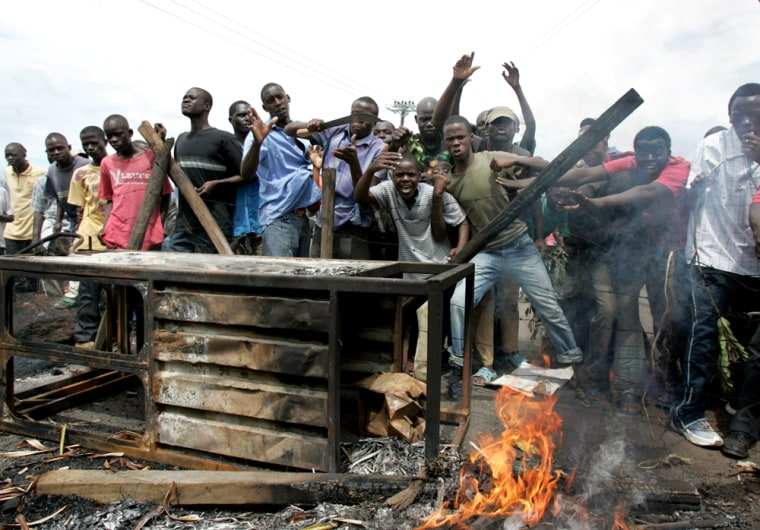 Opposition party supporters react to the camera as they protest in Kisumu, western Kenya, on Wednesday.