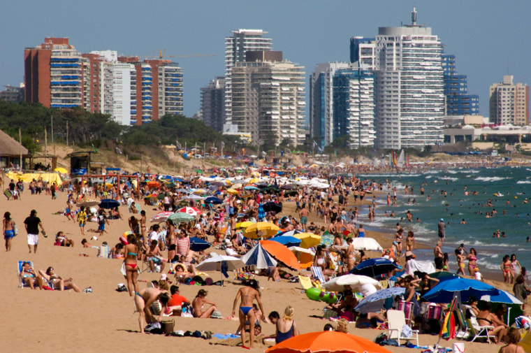 Image: Tourists enjoy summer in a beach of Punta del Este, one of the most exclusive seaside resorts of Latin America.