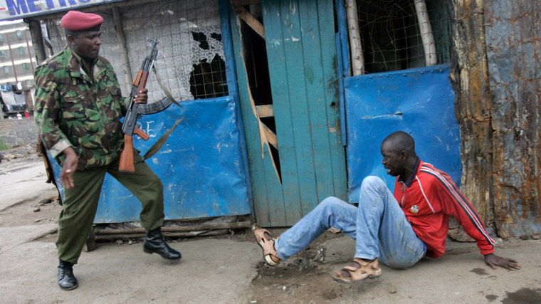 Image: Police officer beats an opposition supporter during riots in Kenya.