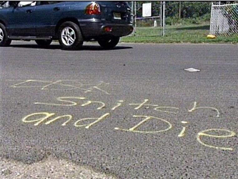 """Image: """"snitch or die"""" graffiti"""