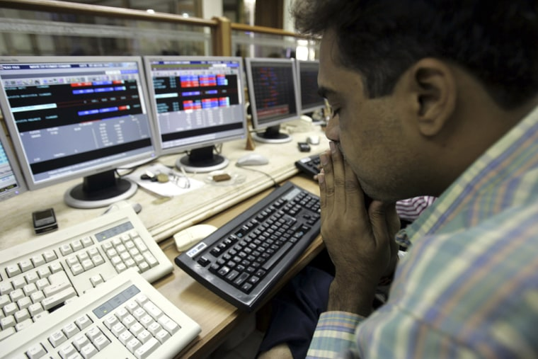 Image: Stock broker at the Bombay Stock Exchange