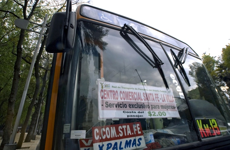 """A bus with a sign reading """"service exclusive for women"""" drives through the streets of Mexico City last week."""