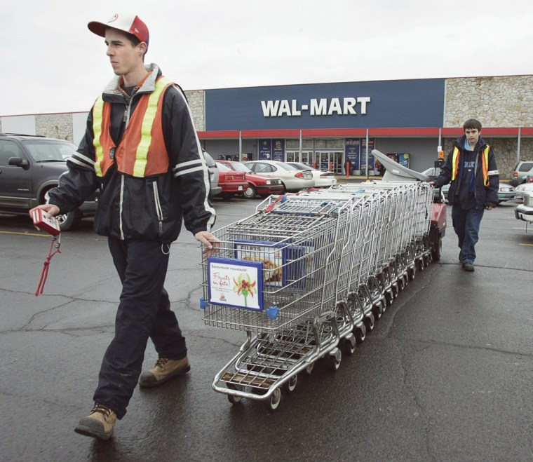 Image: Wal-Mart employees Robert Dion and Jean-Philippe Barrere