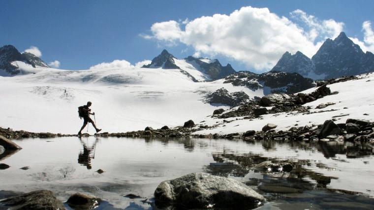 Image: A hiker walks near the Silvretta glacier in the Swiss Alps.