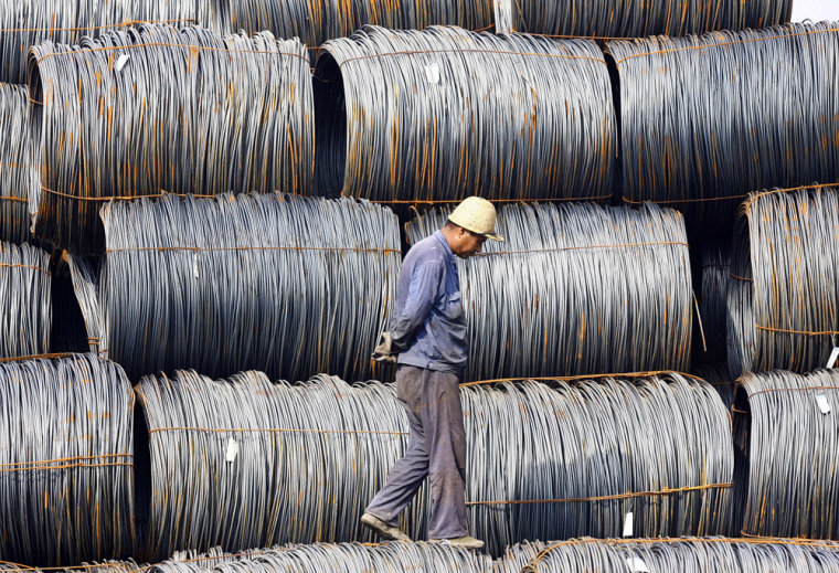 Image: pile of steel at an iron and steel mill yard in Hefei, China