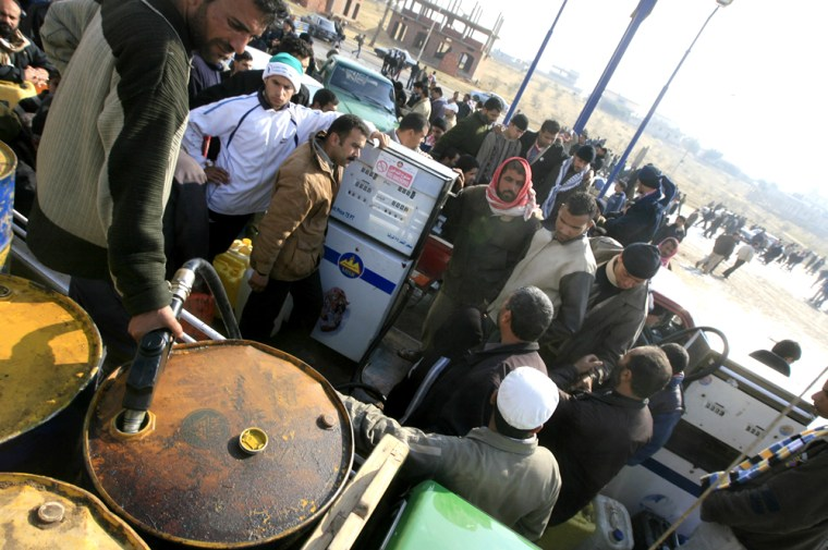 Image: Palestinians from Gaza fill their petrol canisters with gasoline in Rafah, Egypt.