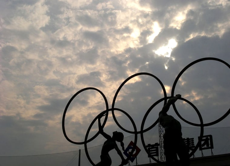 Workers prepare the huge symbolic rings that will adorn the main stadium for the 2008 Olympic Games in Beijing. The official logo of the Olympic Games has long been five interlinked rings, which symbolize the coming together of the Americas, Asia, Europe, Africa and Oceania. China appears to have prepared its commercial aviation system well for the huge influx of air travelers expected to visit Beijing and other Chinese cities for the 2008 Games.