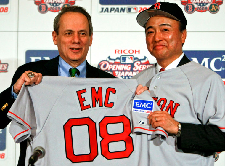 Image: Boston Red Sox Larry Lucchino and Toshio Morohoshi pose for the  photographers