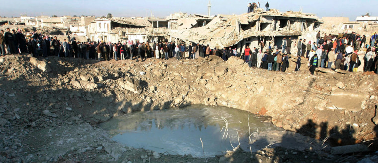 Image: A huge crater at the site of Wednesday's bomb attack in Mosul