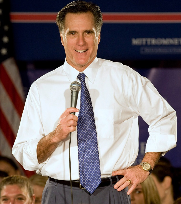 Image: Republican presidential candidate and former Massachusetts Governor Mitt Romney talks with supporters