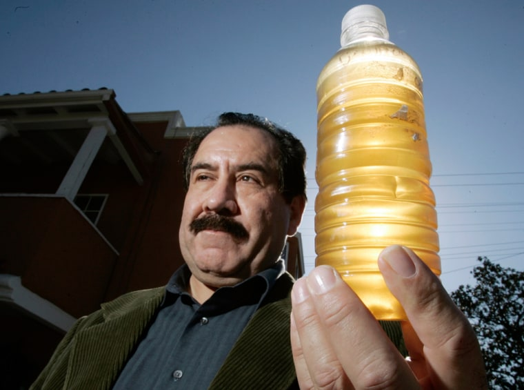 Image: A bottle of discolored tap water in Maywood, Calif.
