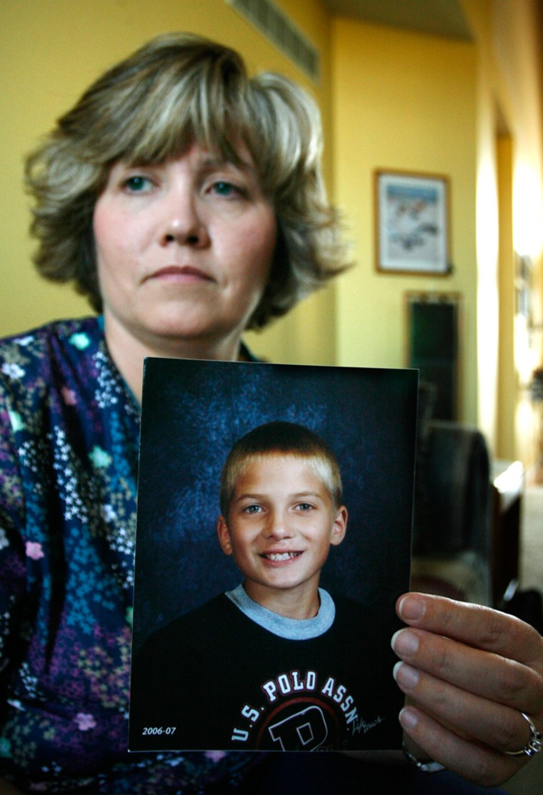 Image: Kim Myers holds a photograph of her son, Brandon