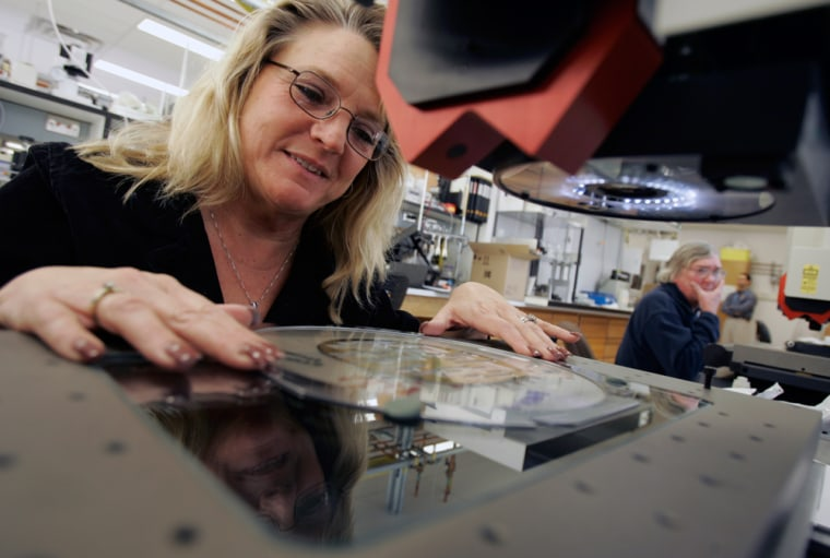Image: Julie Cummings inspects silicon wafers holding print heads at Kodak