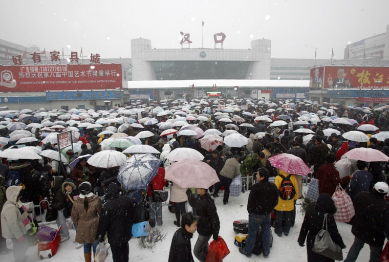 Image: Stranded passengers wait to get into the railway station in Wuhan in central China's Hubei province.
