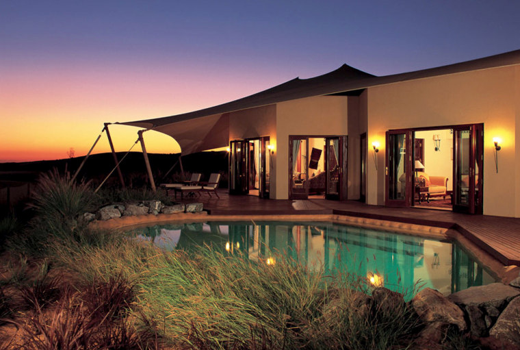 The architecture of the Al Maha Desert Resort follows the traditional style of buildings around dry riverbeds or oases. At $1,090 per night, each of the 32 tented suites is outfitted with antiquities, hand-crafted furniture, rugs and carpets, and a private pool. Activities include falconry, camel-riding and archery