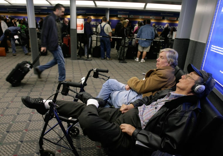 Image: Air travelers wait for flights to resume.