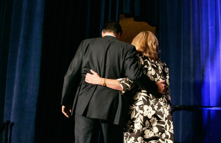 Image:  Mitt Romney and his wife Ann walk away after he dropped out of the presidential race.