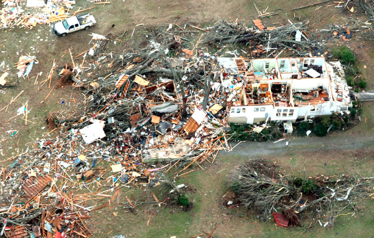 Image: Debris is scattered around a home near Clinton, Arkansas.