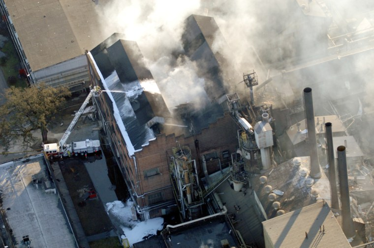 Image: Firefighters continue to fight a fire at the Imperial Sugar Company.