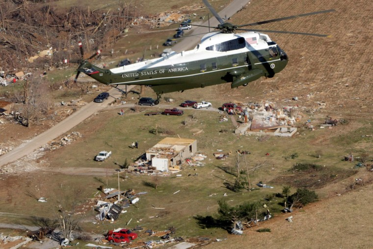 Image: Marine One, with President Bush aboard, flies over tornado damage