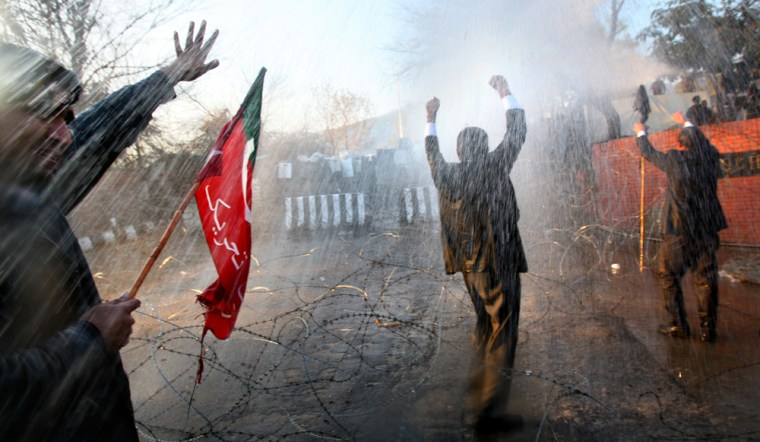 Image: Pakistani lawyers are blasted with a water canon.