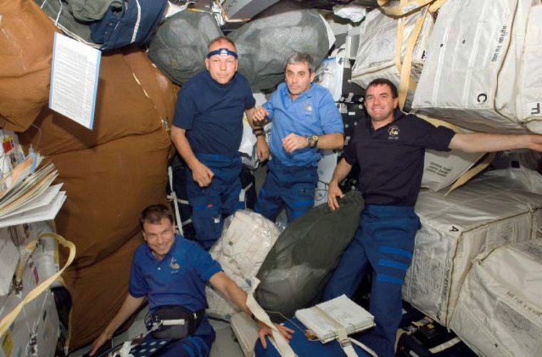 Image: STS-122 mission specialists work on the middeck of the shuttle Atlantis