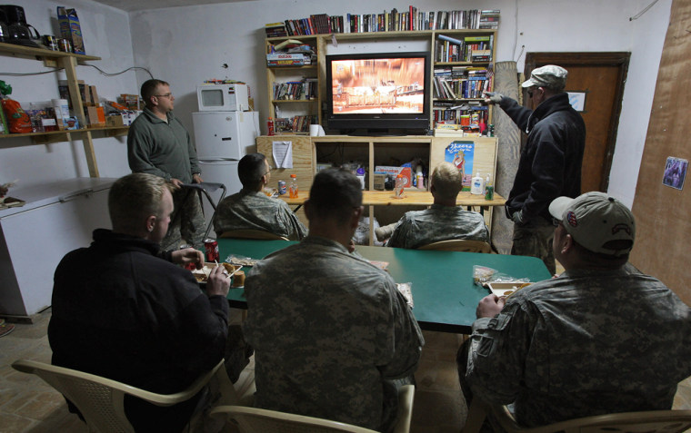 Image: US soldiers play with video games