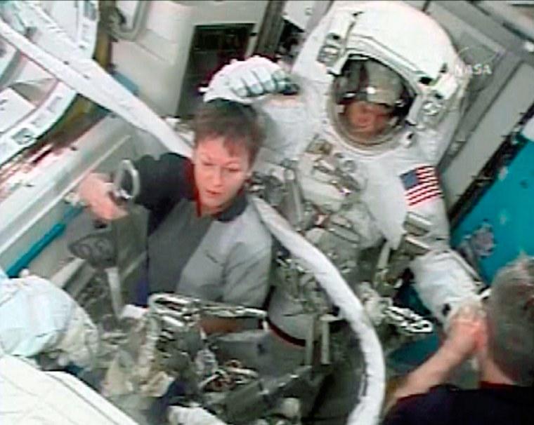 Image: Astronauts prepare for spacewalk.