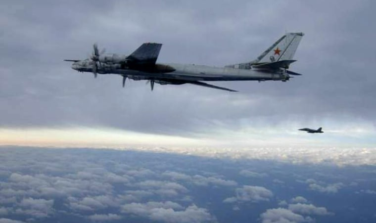 Image:  FA-18 fighter jet escorting a Russian Bear Bomber