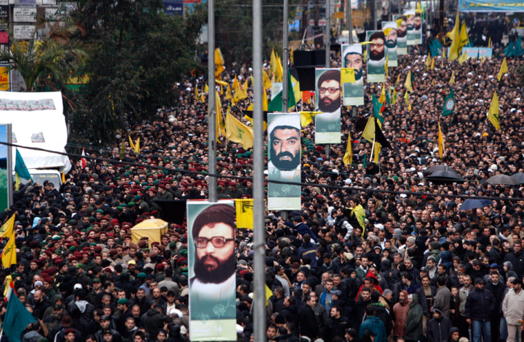 Image: Hezbollah supporters march behind the coffin of Imad Mughniyeh.