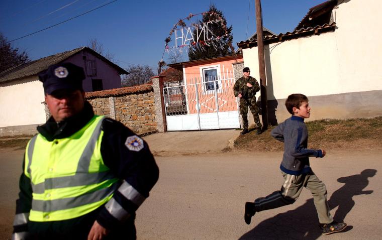 Image: A Serb boy runs in the village of Dobrotin in Kosovo