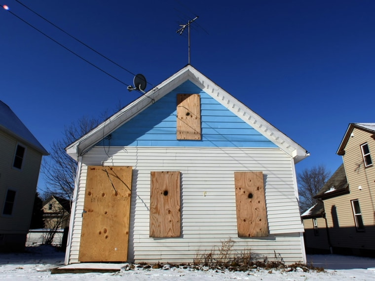 Image: boarded up home