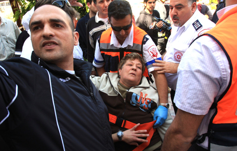 Image: An Israeli woman is treated for shock