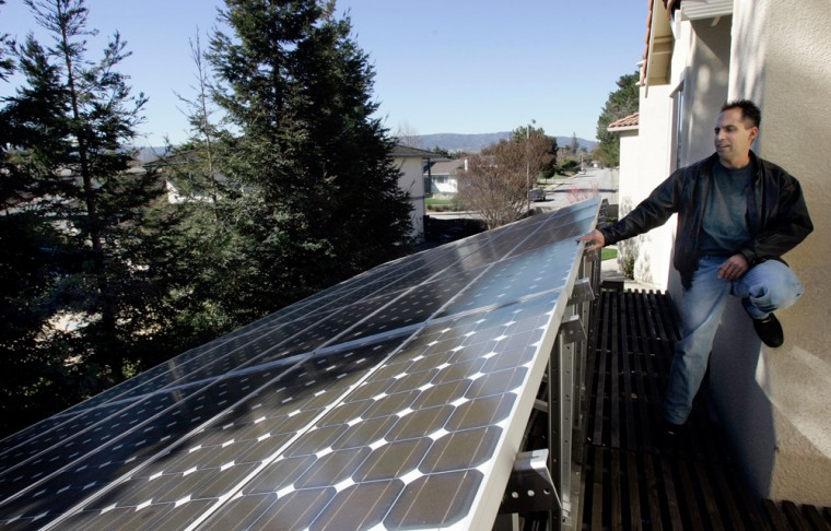 Image: Mark Vargas shows the solar panels on his home