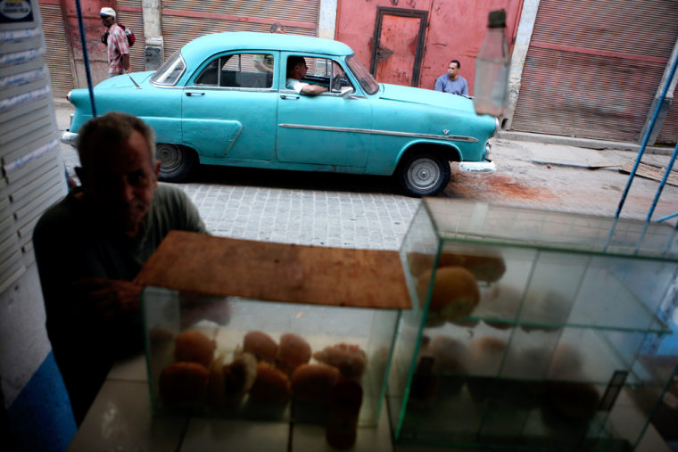 A customer waits to buy a hamburger in Havana, Cuba. Americans hoping Fidel Castro's resignation will bring new travel opportunities are in for a long wait, columnist Christopher Elliott writes.