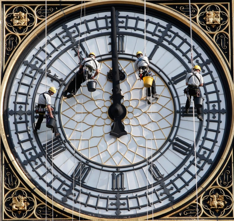 Image: Workers clean Big Ben above the Houses of Parliament in London