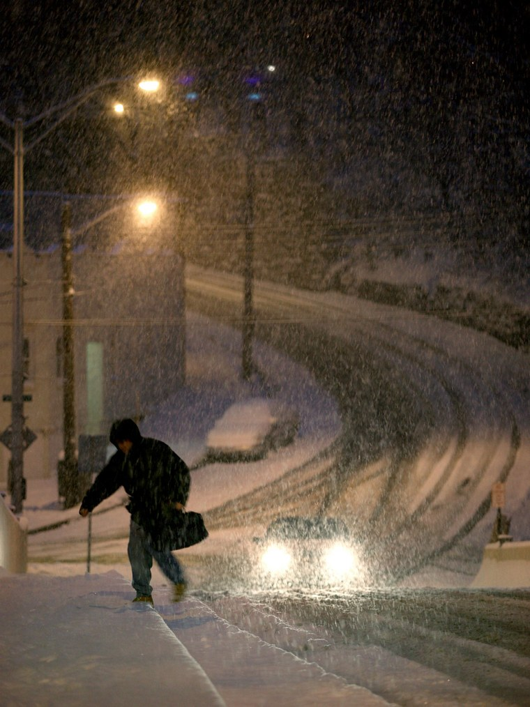 Image: A pedestrian walks in the snow in New York.