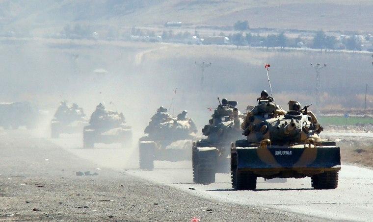 Image: Turkish tanks move near the Iraq border.