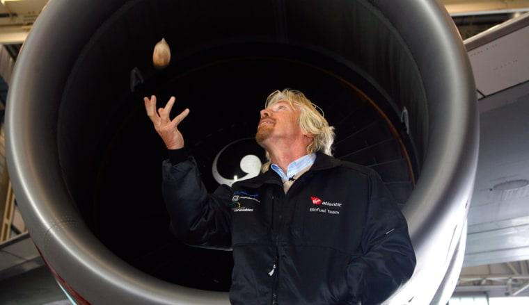 Image: Richard Branson throws a babassu nut