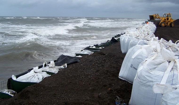 Image: Sandbags are stacked along the seawall in Kivalina, Alaska