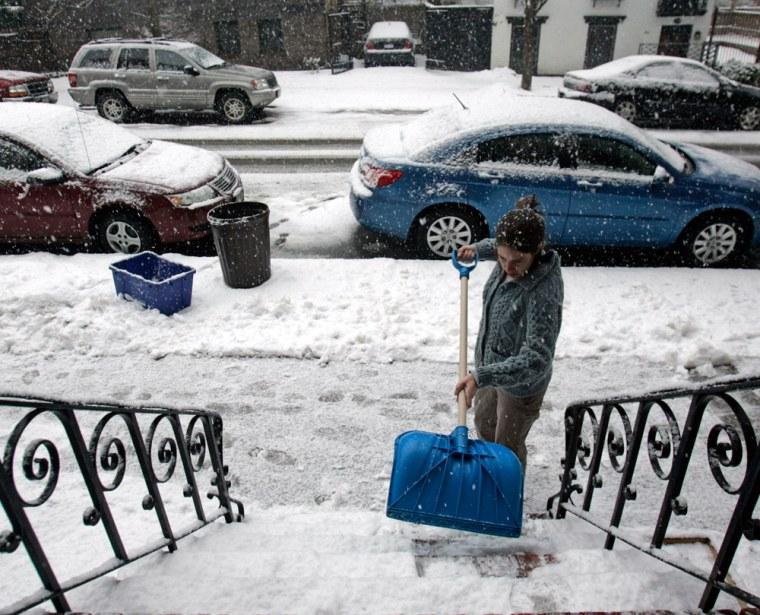 Image: A residents shovels snow in Albany, NY.